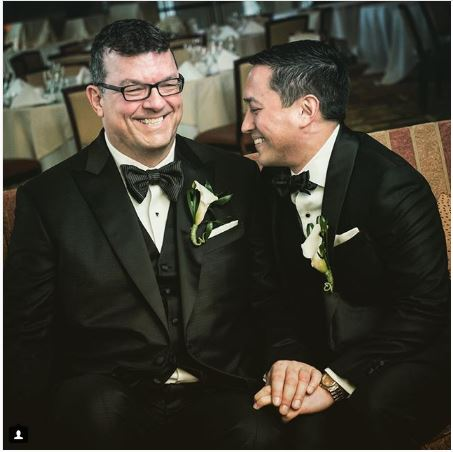 Laughing grooms